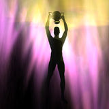 The cup. Silhouette of a man holding up the cup Stock Image