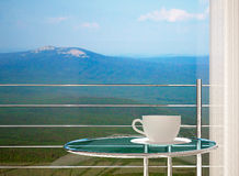 Cup against a landscape Stock Photography
