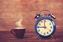 Cup and alarm clock Royalty Free Stock Photos