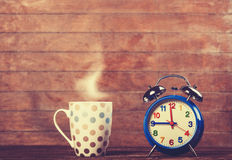 Cup and alarm clock Royalty Free Stock Image