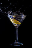 Cup with alcohol. Alcohol aperitif black glass fruit drunk carnival blue Stock Image