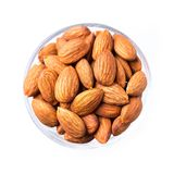 Almonds. A cup of almonds isolated on white royalty free stock photography