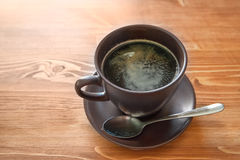 Cup of americano on brown wood table Royalty Free Stock Image