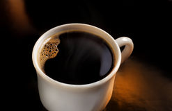 Cup aof coffee. Cup of coffee on dark background Stock Photos