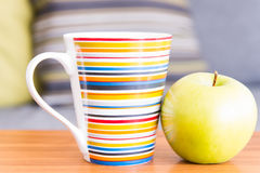 Cup and apple Stock Photography