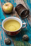 Cup of apple tea Stock Photos