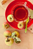 Cup of apple tea Stock Images