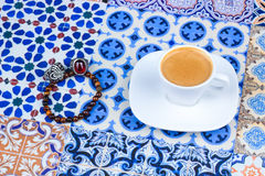 Cup of Arabian Coffee on an Oriental Colorful Background royalty free stock images