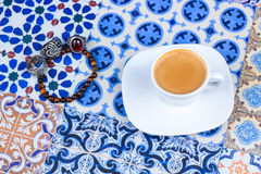 Cup of Arabian Coffee on an Oriental Colorful Background Royalty Free Stock Photos