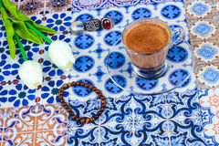 Cup of Arabian Coffee on an Oriental Colorful Background stock photo