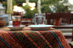 Cup of arabic tea and glass of water Royalty Free Stock Images