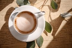 Cup of aromatic coffee for breakfast. On table Stock Images