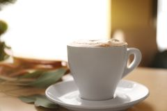 Cup of aromatic coffee for breakfast. On table Royalty Free Stock Images