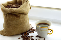Cup of aromatic coffee and coffee beans Stock Image