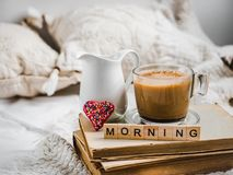 Cup of aromatic coffee, creamer with fresh milk stock image