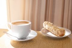 Cup of aromatic coffee and delicious dessert on table. Tasty breakfast Royalty Free Stock Photos