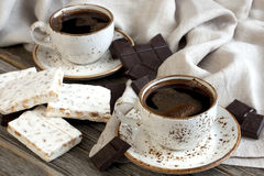 Cup of aromatic coffee with sweets Stock Photo