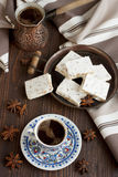 Cup of aromatic coffee with sweets Stock Image