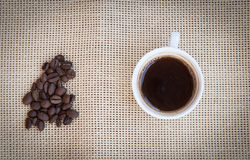 Cup of aromatic espresso black coffee and  beans Royalty Free Stock Images