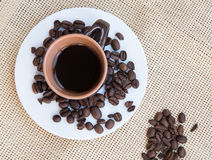 Cup of aromatic espresso black coffee and  beans Royalty Free Stock Image