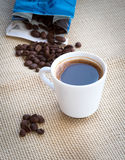 Cup of aromatic espresso black coffee and  beans Stock Photo