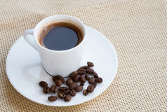 Cup of aromatic espresso black coffee and  beans Stock Photos