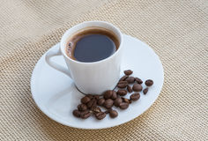 Cup of aromatic espresso black coffee and  beans Royalty Free Stock Photography