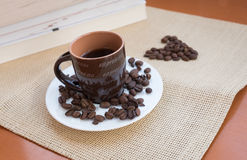 Cup of aromatic espresso black coffee and roasted beans Royalty Free Stock Photo
