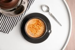 Cup of aromatic hot coffee on table. Top view Royalty Free Stock Photos