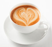 Cup of art cappuccino with a decorative heart Stock Image