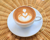Cup of art latte or cappuccino coffee Stock Images