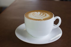 Cup of art latte or cappuccino coffee. Stock Photography