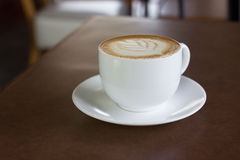 Cup of art latte or cappuccino coffee. Royalty Free Stock Images