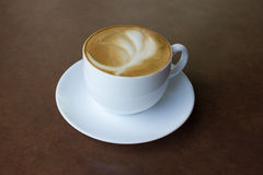Cup of art latte on a cappuccino coffee Royalty Free Stock Image