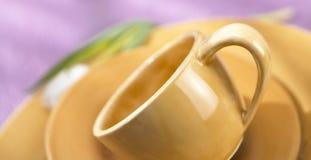 Cup auf Saucer Stockfotos