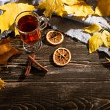 A cup of autumn tea and yellow dry leaves. Copy space. Hot drink for autumn cold rainy days. Hygge concept, autumn mood. flat lay. Leaf comfort relax home stock photography