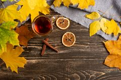 A cup of autumn tea and yellow dry leaves. Copy space. Hot drink for autumn cold rainy days. Hygge concept, autumn mood. flat lay. Leaf comfort relax home stock images