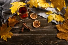 A cup of autumn tea and yellow dry leaves. Copy space. Hot drink for autumn cold rainy days. Hygge concept, autumn mood. flat lay. Leaf comfort relax home royalty free stock photo