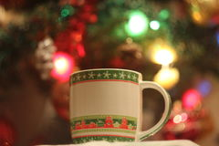 Cup on the background of garlands Royalty Free Stock Photo