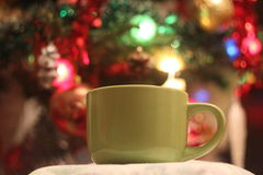Cup on the background of garlands Stock Photo