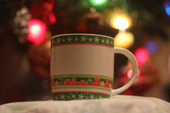 Cup on the background of garlands Royalty Free Stock Images