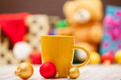 Cup with baubles Royalty Free Stock Photos