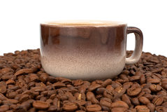 Cup on beans Stock Images