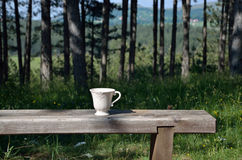 Cup on a bench Royalty Free Stock Photography