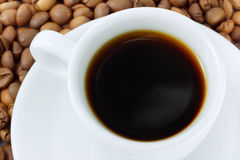 Cup with beverage and coffee beans Stock Photography
