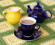 Cup of beverage. jug and teapot on back plane Royalty Free Stock Photography