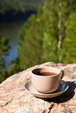 Cup on big stone over nature background Stock Image