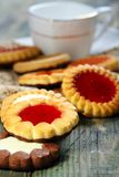 Cup and biscuit with jelly filling. Stock Photo