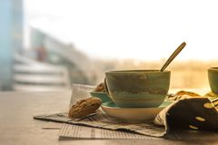 Cup of black coffe with spoon on supported dish on fabric on bla Royalty Free Stock Photos