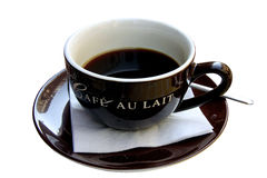 Cup of black coffee. Isolated cop of black coffe with Cafe au lait wrote on the side Royalty Free Stock Photo